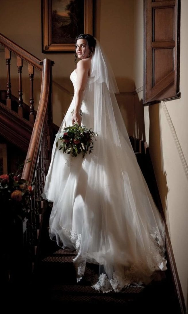 Bride wears The Cannon Veil, chapel length in medium ivory tulle.